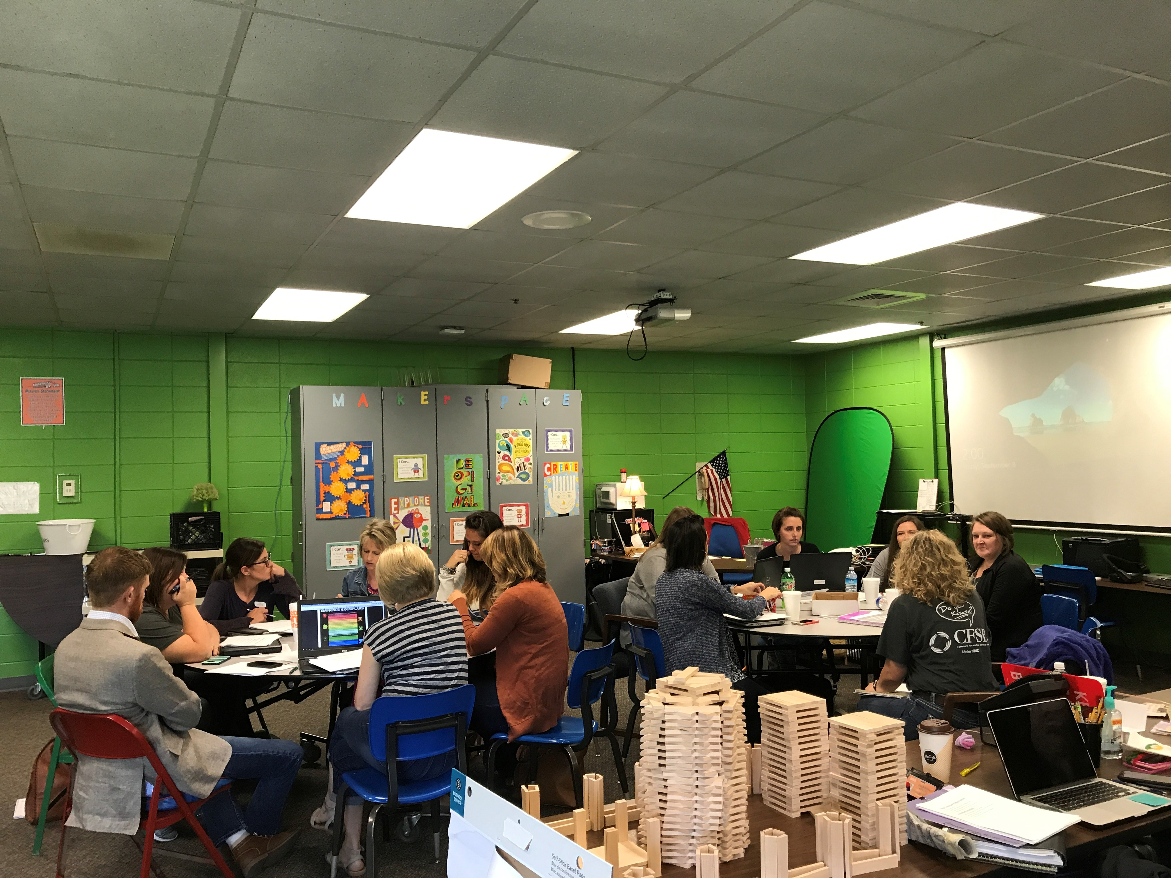 Teachers and principals meet in CES' Makerspace room